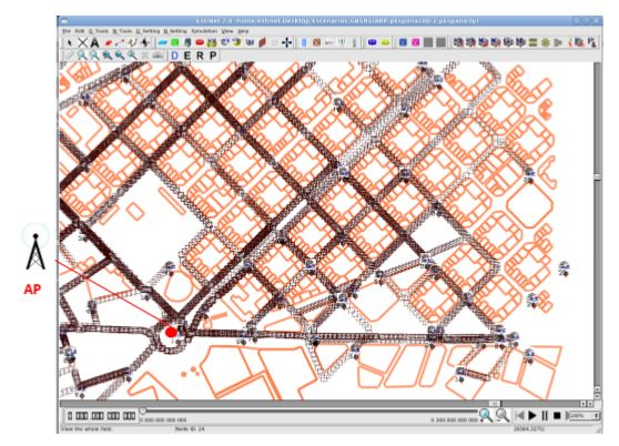 Figure 3. Simulation scenario. Eixample district of Barcelona, Spain, with an Access Point (AP). Buildings (orange lines) from Open Street Map are included