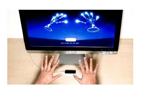 Figure 1: The Leap Motion in use, with onscreen graphic representation of data generated